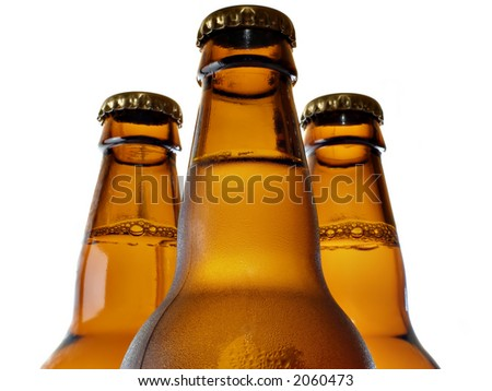 Upper part of three beer bottles - stock photo