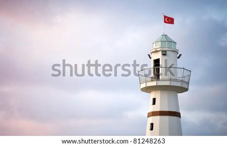 Upper part of white Lighthouse with Turkish flag on top. Avsallar, Alanya, Turkey - stock photo