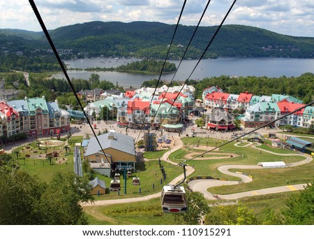 Upper resort village of Mont Tremblant, Place St. Bernard, seen from the cable car in summer - stock photo