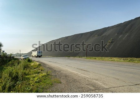 UPPER UFALEY, RUSSIA - AUGUST 11. Mountain of the metal slag along the route in Upper Ufaley on August 11, 2013. - stock photo