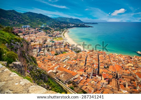 upper view of the bright orange houses near the sea, Cefalu, Sicily, Italy - stock photo