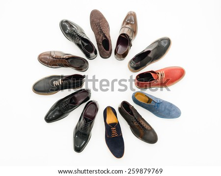 upper view, variety of male shoes arranged in circle, isolated on white background - stock photo