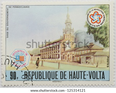 UPPER VOLTA - CIRCA 1976: A stamp from Upper Volta (present day Burkina Faso) shows image commemorating the Siege of the Government of Pennsylvania and commemorates the US bicentennial, circa 1976