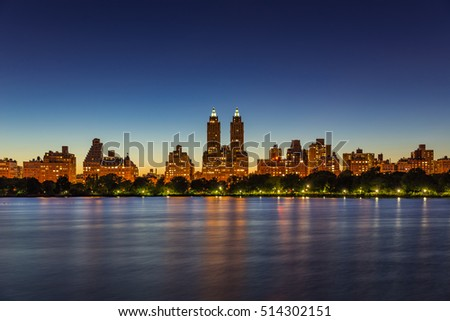 Upper West Side buildings and Central Park. Jacqueline Kennedy Onassis Reservoir at twilight. Manhattan city lights, New York City