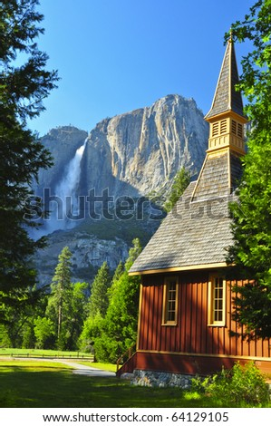 Upper Yosemite Falls and Yosemite Chapel on a gorgeous day. Yosemite National Park, California - stock photo