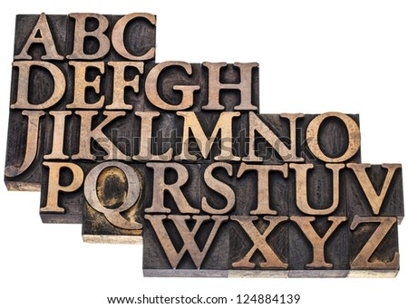 uppercase English alphabet in vintage letterpress wood type printing blocks, isolated on white - stock photo