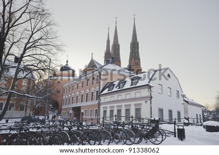 Uppsala view. Detail from Uppsala old town, with the cathedral in the background and student bikes in the foreground. - stock photo