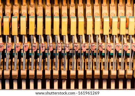 Upright piano dampers and hammers - stock photo