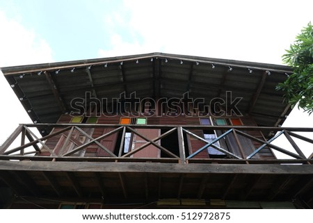 Uprise angle shot Thai style wooden house with balcony