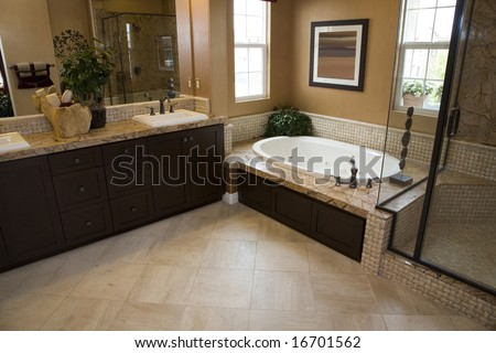 Upscale bathroom with a modern tub and tile floor. - stock photo