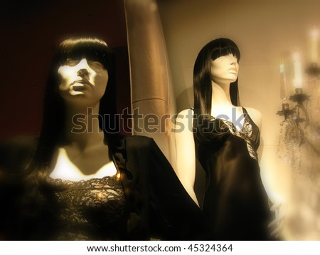 Upscale boutique display of mannequins in sleepwear. Soft focus borders for ambiance. - stock photo