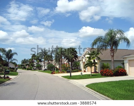 Upscale bungalows on tropical American street. - stock photo