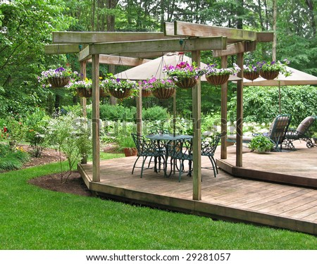 Upscale dining terrace decorated with hanging baskets of petunias - stock photo