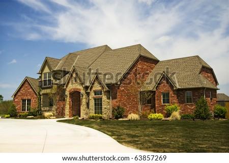 Upscale Family Home A nice single family custom house. Horizontal. - stock photo