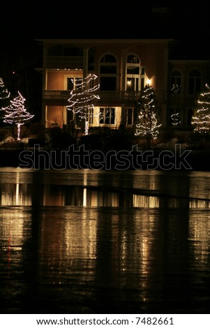 Upscale home with christmas decorations and lights - stock photo