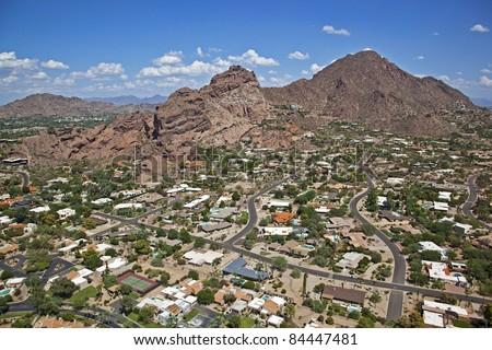 Upscale homes at the base of Camelback Mountain in Phoenix, Arizona - stock photo