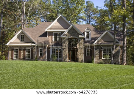 Upscale house in wooded area - stock photo