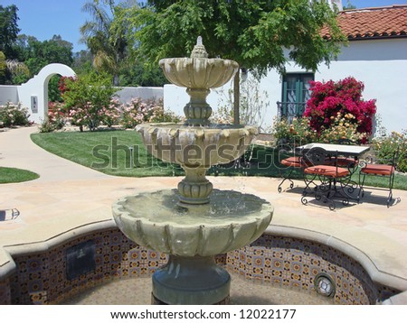 Upscale inn and spa in Southern California, with fountain and arched entry - stock photo