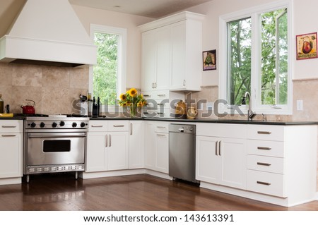 Upscale kitchen in a modern home - stock photo