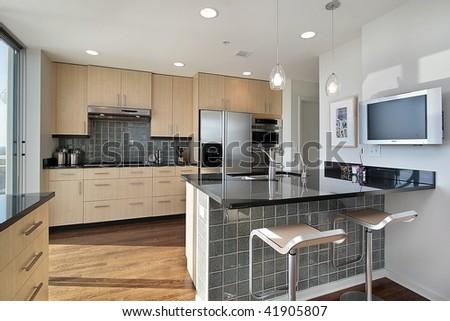 Upscale kitchen in modern condo - stock photo