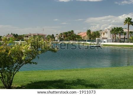 Upscale lake homes - stock photo