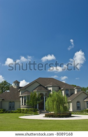 Upscale large home with big blue sky vertical