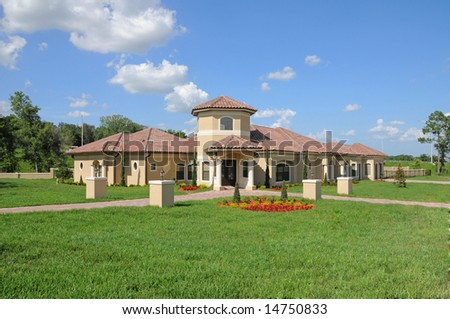 Upscale model home in Central Florida with blue sky - stock photo