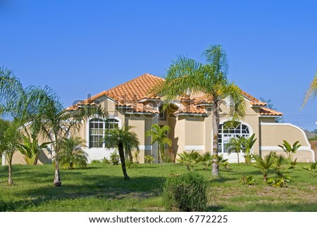 Upscale Spanish style home in Central Florida with blue sky - stock photo