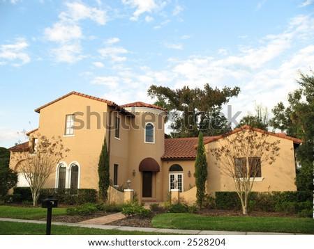 upscale stucco home in affluent American neighborhood - stock photo