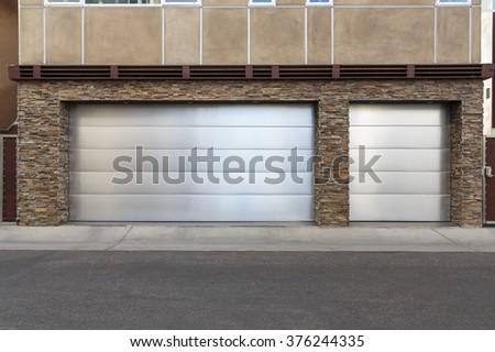 upscale three car garage door with metal - stock photo