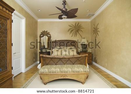 upscale tropical decor bedroom - stock photo