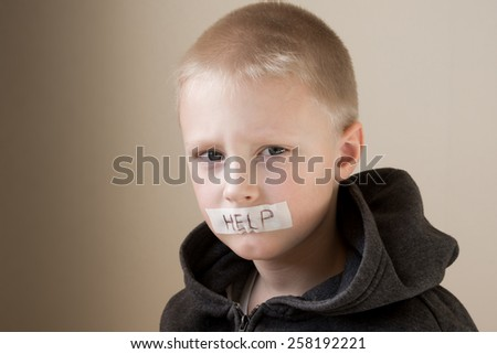 Upset abused frightened little child (boy), help, close up horizontal portrait with copy space - stock photo