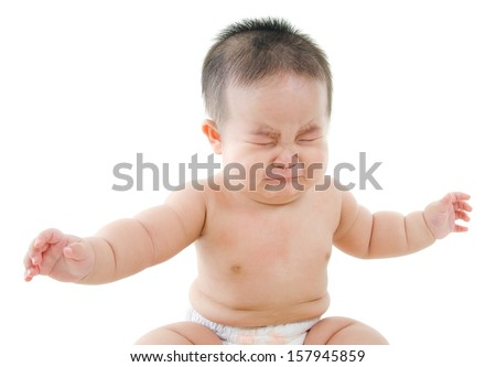 Upset Asian baby boy crying, sitting isolated on white background - stock photo