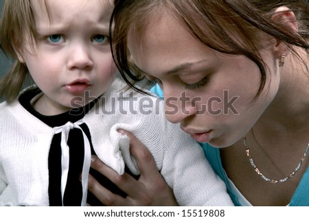 Upset baby with mother - stock photo