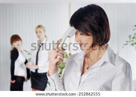 Upset business lady with phone tube in office - stock photo