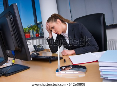 upset business woman in office looking at computer