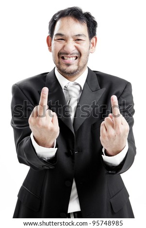 Upset businessman giving middle finger - stock photo