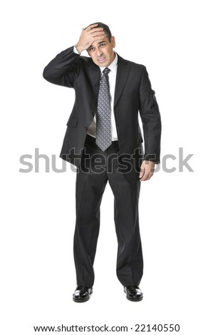 Upset businessman in a suit isolated on white background