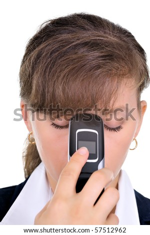 Upset businesswoman after talking on cellphone - stock photo