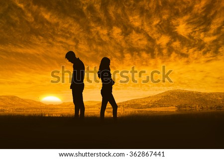 Upset couple not talking to each other after fight against beautiful african scene - stock photo
