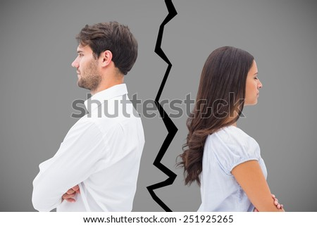 Upset couple not talking to each other after fight against grey - stock photo