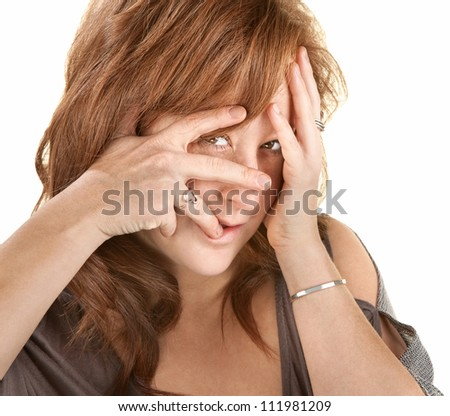 Upset European woman with face in her hands - stock photo