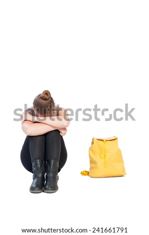 Upset girl holding her head down. Bullying concept on white background. - stock photo