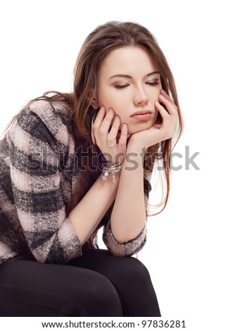 Upset girl sitting on a chair - stock photo