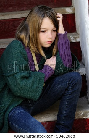 upset girl standing on stairs