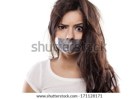 upset girl with self-adhesive tape over her mouth - stock photo