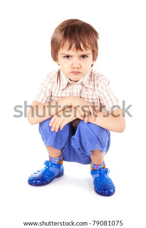 Upset little boy on white background - stock photo