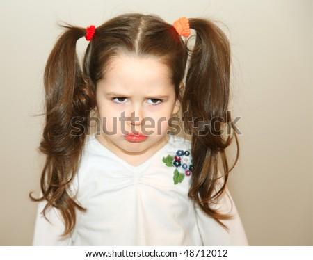 Upset little girl - stock photo