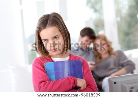 Upset little girl who has to do homeworks - stock photo
