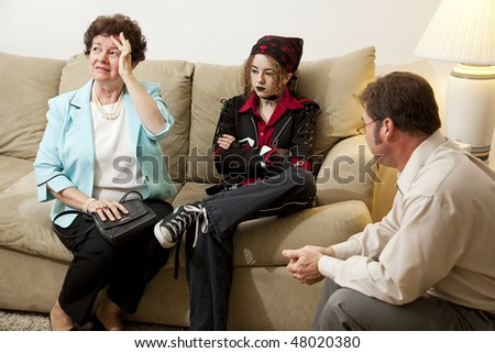 Upset mother seeks counseling with her rebellious teenage daughter. - stock photo